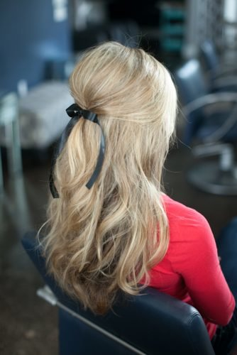 mother of the bride hairstyles half up with black bow on blonde hair marthalynnkale