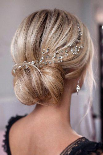 mother of the bride hairstyles oliginal low bun decorated with silver accessories tonyastylist