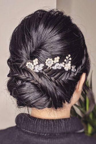 mother of the bride hairstyles on black hair low bun with silver hair pin and braids bridal_hairstylist