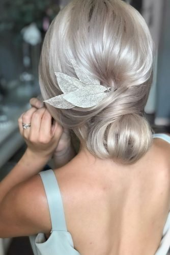 mother of the bride hairstyles on white hair with relaxed low chignon and gentle leaves pins martinajagr