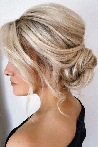 mother of the bride hairstyles simple messy low bun on blonde hair pearly.hairstylist