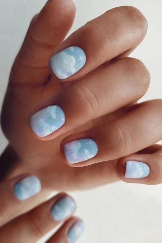 nail ideas light blue with white clouds safinailstudio