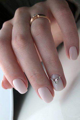 pinterest nails gentle manicure with pink rhinestones on one finger yadevochkamilana via instagram
