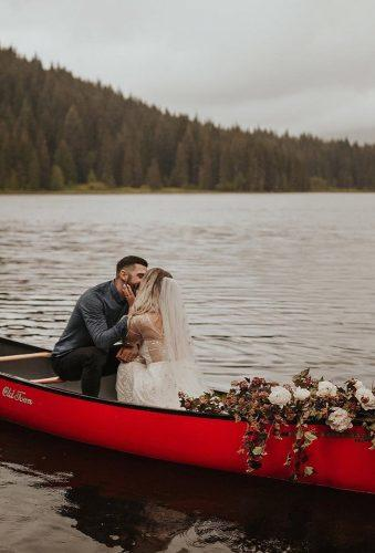 romantic photos wedding day couple in red boat dawn photo