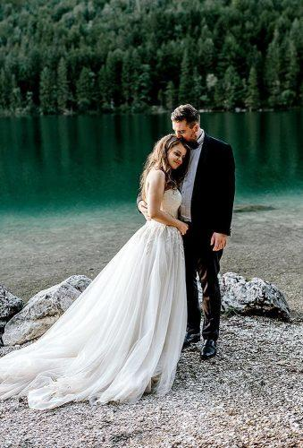 romantic photos wedding day couple near lake le karina