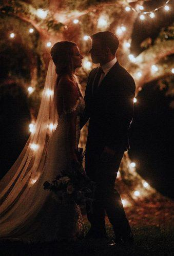 romantic photos wedding day couple near light tree brooke couch