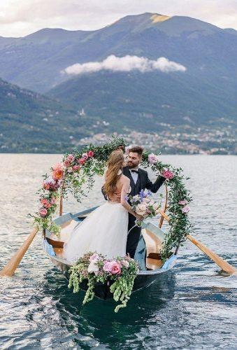 romantic photos wedding day flower wreath in boat roman_ivanov_weddings