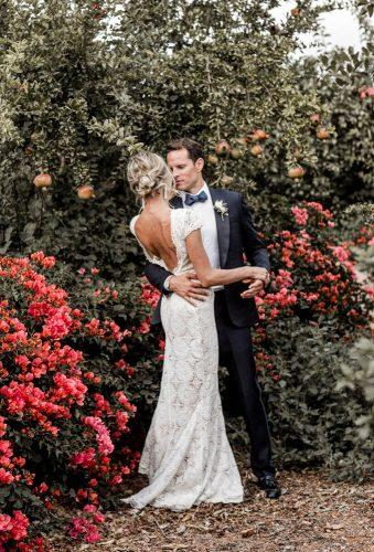 romantic wedding couple in red flower elisabettalillyred