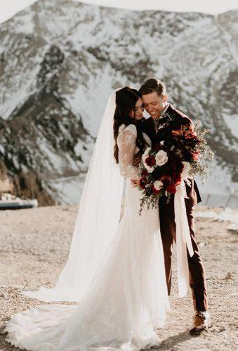 romantic wedding couple in snow mountains peytonrbyford