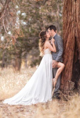 romantic wedding kiss near tree michaelanthonyphotography
