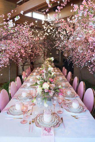rose gold wedding decor bright reception with flowers hermanauphoto