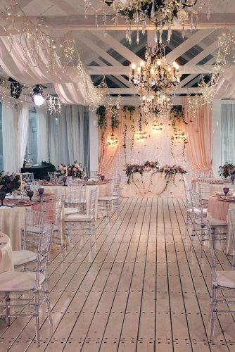 rose gold wedding decor reception in white barn with cloth and lighting lattedecor
