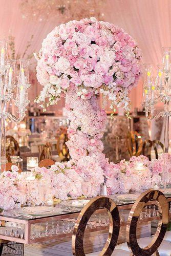 rose gold wedding decor tall centerpiece with roses duke photography via instagram