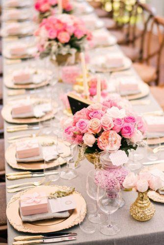 rose gold wedding roses in pink shades on the wedding table with golden dishes studio impressions photography