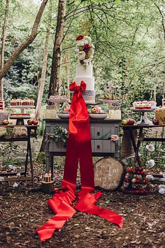 rustic backyard wedding decoration dessert table with cake with red ribbons chloeleephoto via instagram