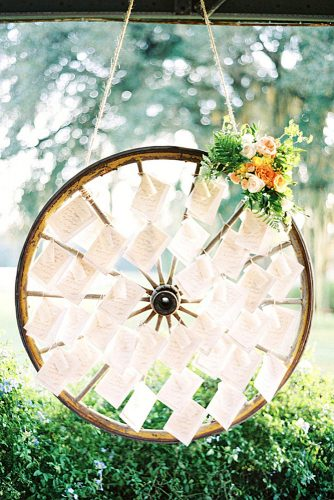 rustic backyard wedding decoration escort card display on a wheel hunter ryan photo