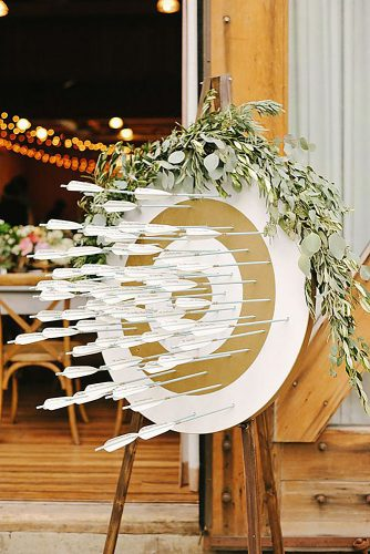 rustic backyard wedding decoration escort card display with arrows rebekah westover