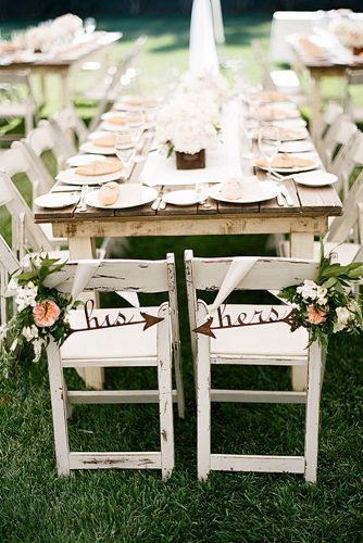 rustic backyard wedding decoration light wooden table and chairs with flowers and inscriptions clayton austin
