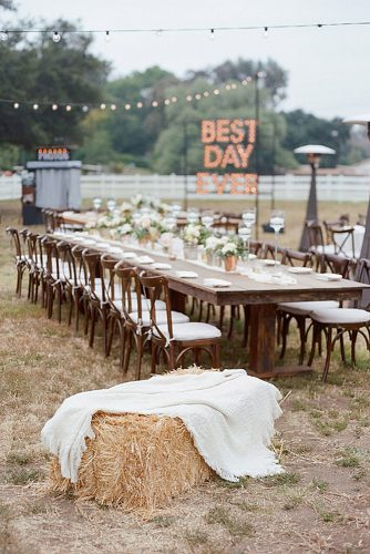 rustic backyard wedding decoration long wooden table with flowers on the background of the inscription from the lights bryan n miller photography