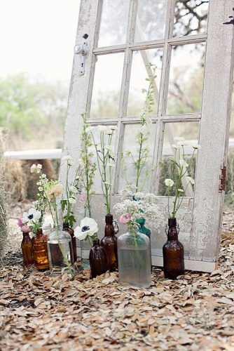 rustic backyard wedding decoration old door and flowers in a glass bottle peacock photography