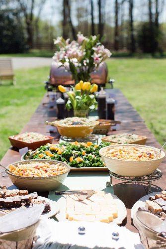 rustic-barbecue-bbq-wedding-food-bar-on-a-long-table-with-treats-and-flowers-shalese-danielle-via-instagram