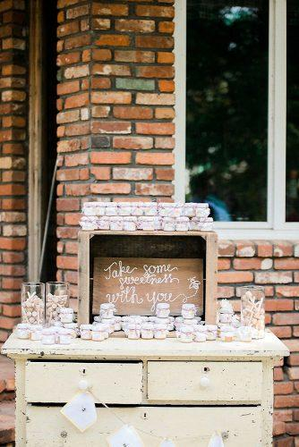 rustic barbecue bbq wedding on a vintage chest of drawers a wooden box with an inscription and sweets heather selzer via instagram