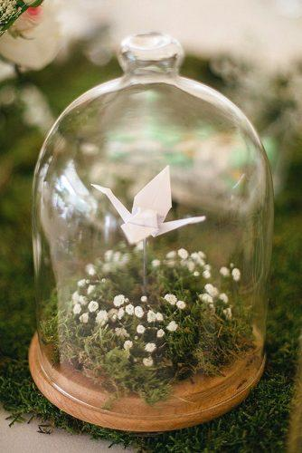 rustic barbecue bbq wedding stand with moss flowers and paper swan under transparent dome estudio dita via instagram