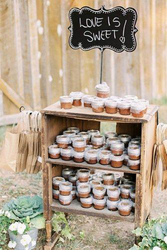 rustic barbecue bbq wedding wooden old cabinet with treats and paper bags juicebeats photography via instagram