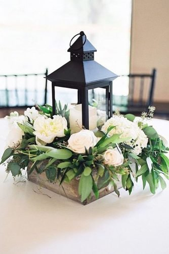 rustic wedding reception elegant centerpiece with lantern and white flowers tracy enoch photography