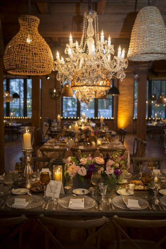 rustic wedding reception elegant indoor crystal chandelier and flower on tables wholehearted wedding films