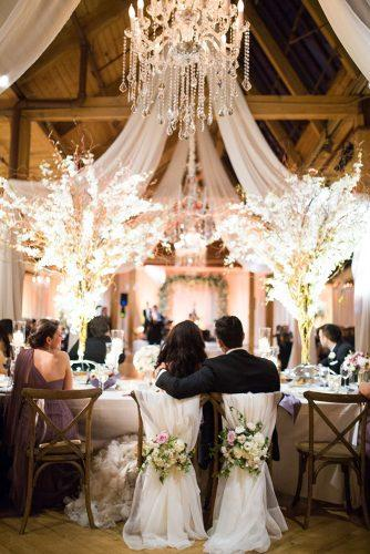 rustic wedding reception glam elegant with bright flowers and chandeliers studio this is
