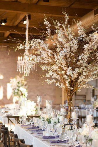 rustic wedding reception glam rustic wedding table with tall centerpiece with branches and flowers studio this is