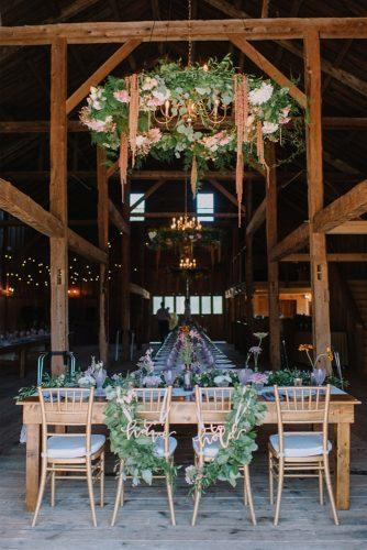 rustic wedding reception in the barn with hanging greenery darling photo