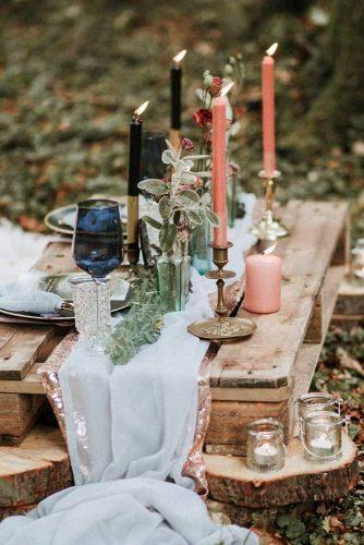 rustic wedding reception in the wood low pallette table with candles thewhiteemporium