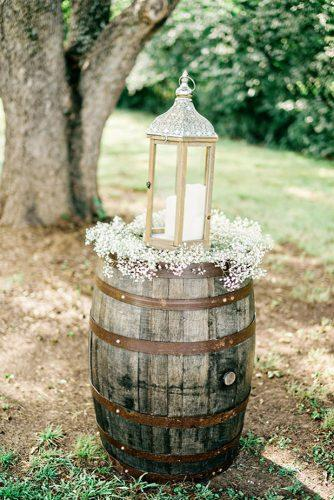 rustic wedding reception lantern with baby breath on vine barrel andie freeman photography