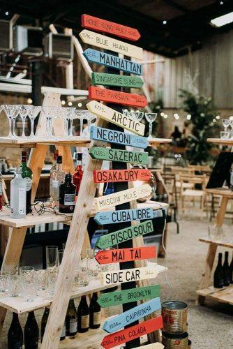rustic wedding reception simple wooden bar idea with signs on stairs rose and spear photography