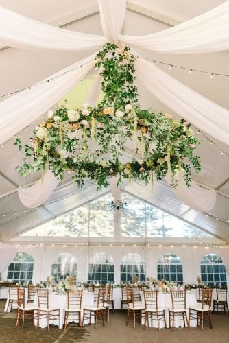 rustic wedding reception under white tent hanging greenery decor michelle lange photography