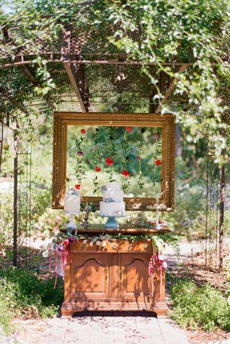 rustic wedding reception vintage dessert table decorated with suspended flowers in frame the ganeys
