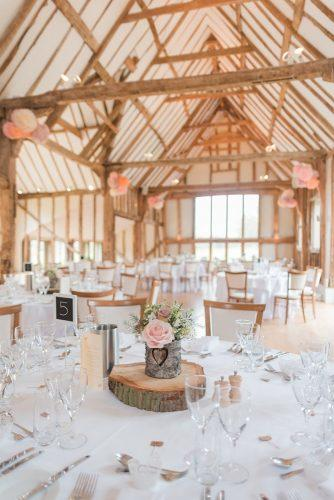 rustic wedding reception white blush in the barn with pink roses kerrie mitchell photography