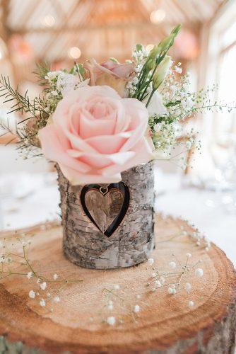 rustic wedding reception wooden centerpiece with pink rose kerrie mitchell photography