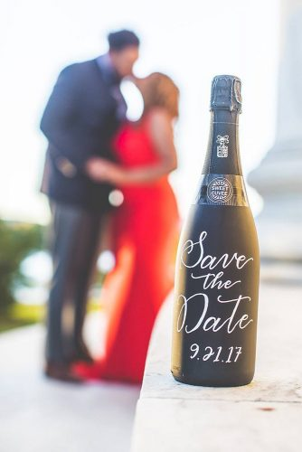 save the date photo ideas black bottle with date of steam kisses in the background allison mclaughlin via instagram
