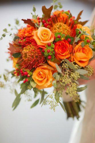 silk wedding bouquets orange rose ludemas