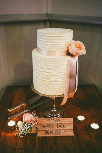 small rustic wedding cakes elegant buttercream with pink flower and stripes thecakeandi
