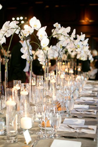 tall wedding centerpieces in high vases branches with white orchids josh gruetzmacher photography