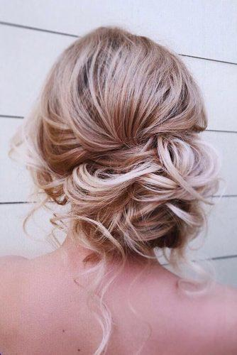 timeless bridal hairstyles messy curly low side bun kamalova via instagram