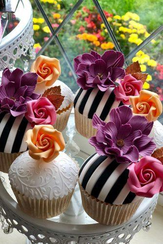 unique wedding cupcake ideas black white stripes with bright orange and violet flowers hinarasool