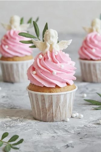 unique wedding cupcake ides with pink buttercream and white angel figure tastygram.ru