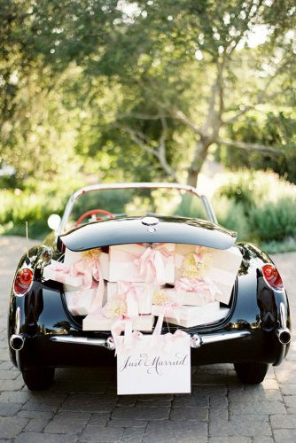 wedding car decorations black car with gifts in the trunk and an inscription just married arrsla via instagram