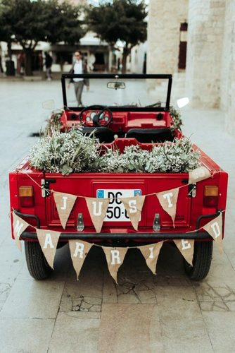 wedding car decorations red pickup with greens and a burlap garland with an inscription just married lorenzo accardi photography