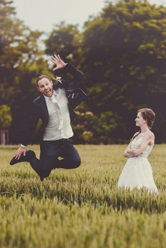 wedding entourage photo ideas bride and groom jump field photographer jaromir zubak